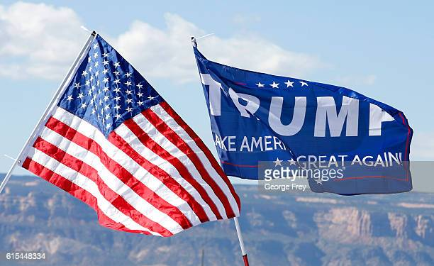 With the Colorado National Monument in the background an American flag and a Trump flag flies at a rally where Republican Presidential Candidate...