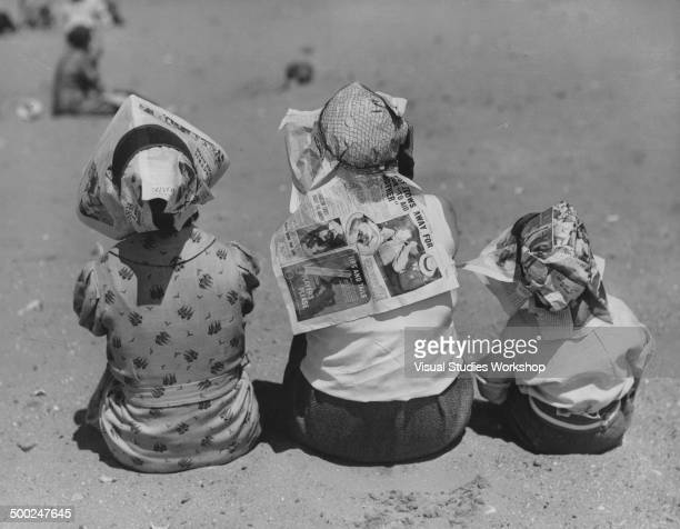 With the coming heat wave so comes new ideas for keeping cool which these people demonstrate by wearing improvised sun protectors made from...