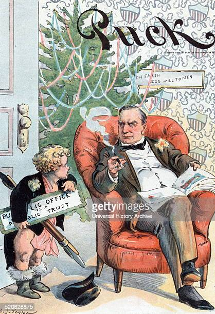 With the compliments of the season' Presidentelect William McKinley sitting in a chair reading a magazine with a Christmas tree in the background...