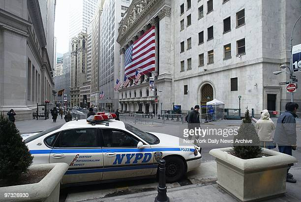 With the country on a Code Orange security alert Wall St in front of the flagbedecked New York Stock Exchange is closed to traffic