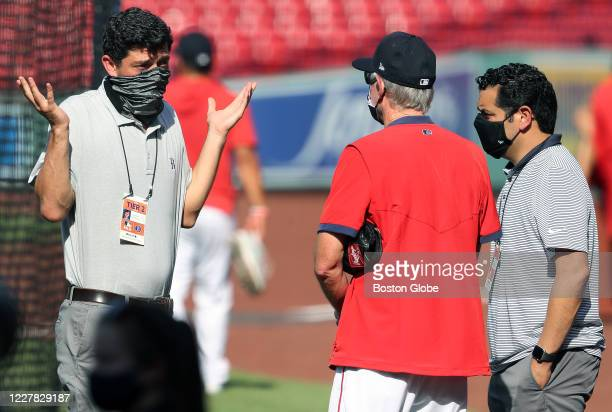 With the COVID19 scare impacting baseball Chief Baseball Officer Chaim Bloom left has an animated chat with manager Ron Roenicke center and Assistant...