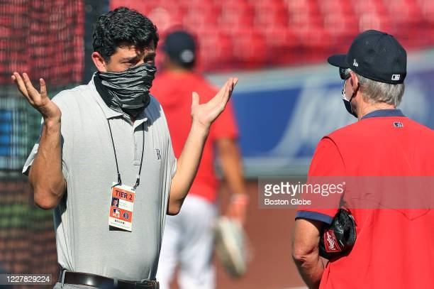 With the COVID19 scare impacting baseball Chief Baseball Officer Chaim Bloom left has an animated chat with manager Ron Roenicke right during batting...