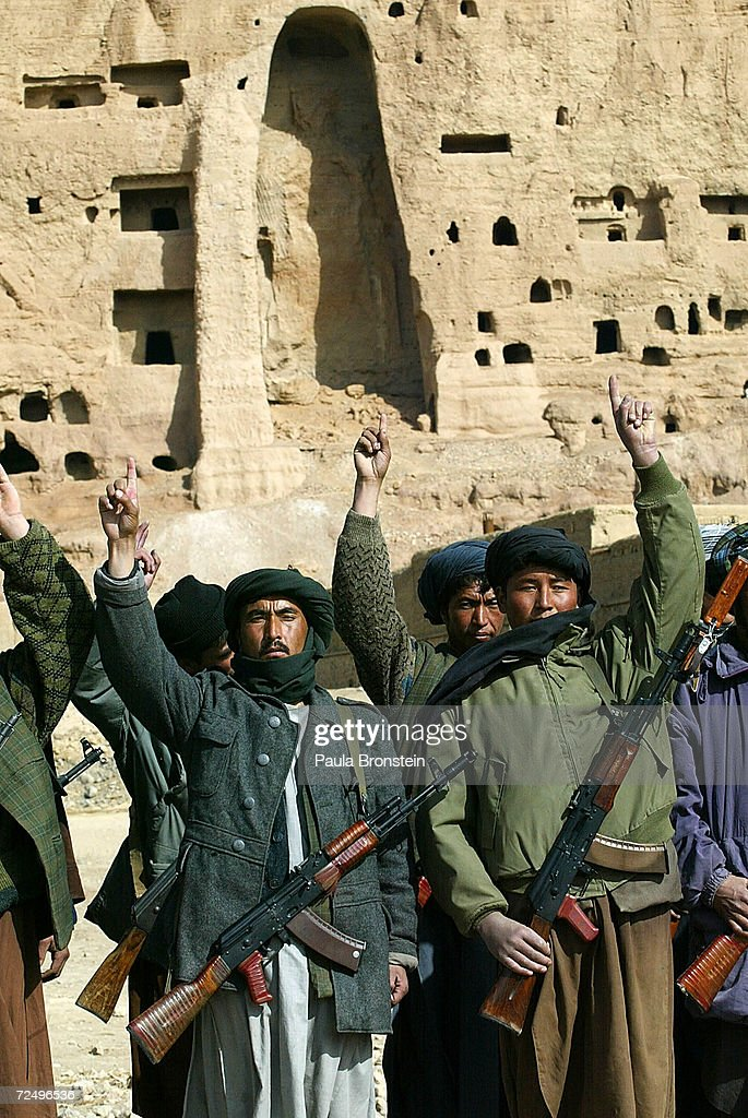 With the destroyed Buddha statue in the background, soldiers loyal to commander Mohammad Kharim Khalili go through basic training February 20, 2002 in Bamiyan, Afghanistan. Khalili has complete control over the Bamiyan region and the Hazara people that live in central Afghanistan. The Taliban blew up the statue last year.
