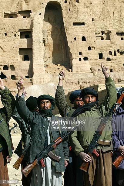 With the destroyed Buddha statue in the background soldiers loyal to commander Mohammad Kharim Khalili go through basic training February 20 2002 in...