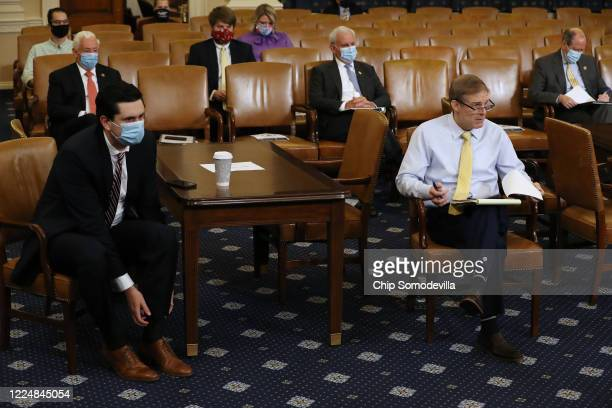 With the exception of Rep Jim Jordan members of Congress and their staff wear face masks during a House Rules Committee hearing about the proposal to...