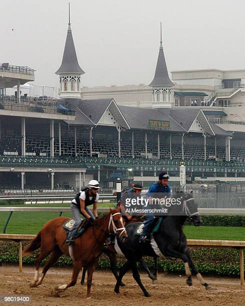 With the famous twin spires as a backdrop a horses and riders work out before racing at Churchill Downs May 4 2007 in Louisville