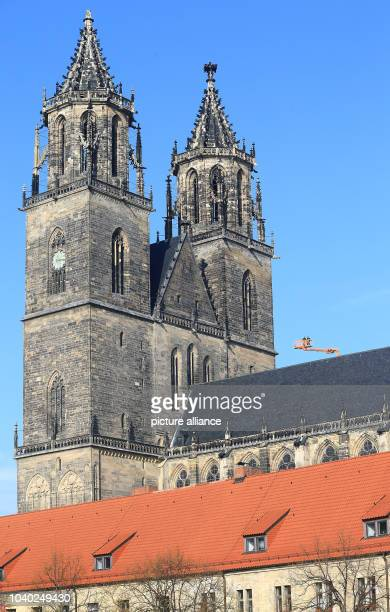 With the help of a cherry picker the facade of Magdeburg Cathedral 'St Catherine and St Maurice' is inspected in Magdeburg Germany 29 October 2014...