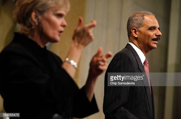 With the help of a sign language interpreter US Attorney General Eric Holder addresses the Department of Justice�s commemoration of the 20th...