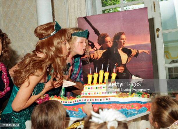 With the help of her mother, actress Marla Maples , Tiffany Trump blows out the candles on her 'Titanic'-themed cake during her fifth birthday party...