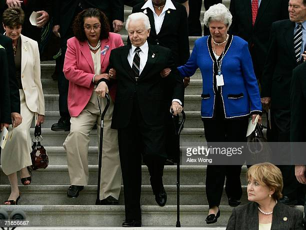 With the help of two Senate staffers Cindy Hasiak and Mary Arnold US Sen Robert Byrd walks down the East Steps of the US Capitol with other...