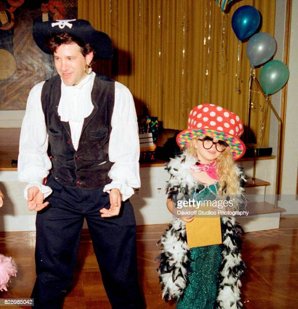 With the help of unidentified actors Tiffany Trump and guests play a limbo game during her fifth birthday party at the MaraLago estate Palm Beach...