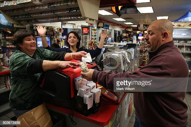 With the Jackpot now at 500 million Gale Call and Sherrie Haines sell a Powerball ticket to Mike Nastasi at the BP gas station January 6 2015 in...