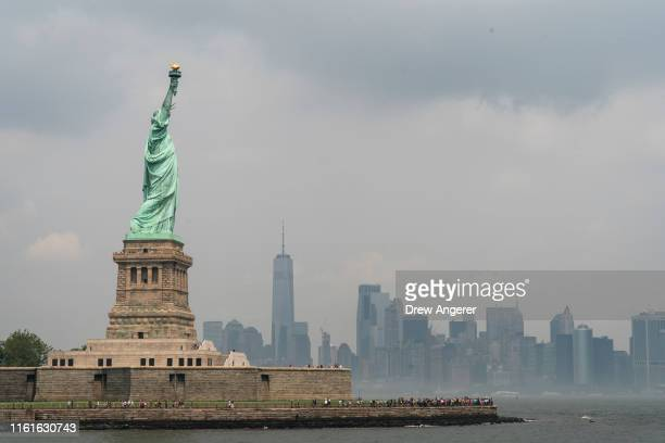 With the Lower Manhattan skyline behind it the Statue of Liberty stands on Liberty Island August 14 2019 in New York City On Tuesday acting Director...