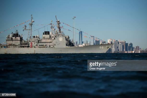 With the Lower Manhattan skyline in the background the USS Hue City sits docked in New York Harbor November 10 2017 in the Staten Island borough of...