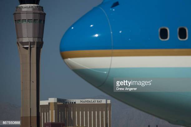 With the Mandalay Bay Resort and Casino in the background Air Force One arrives at McCarran International Airport October 4 2017 in Las Vegas Nevada...