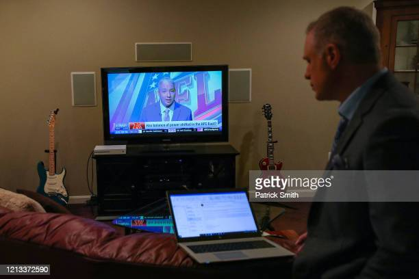 With the NFL Network on the television WBALSports Anchor/Reporter Pete Gilbert checks his computer following a standup report on the 2020 NFL Free...