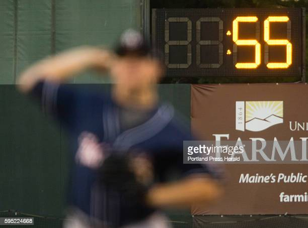 With the pitchers warm up clock running in the background a New Hampshire Fisher Cats pitcher warms up during AA baseball action against the Portland...