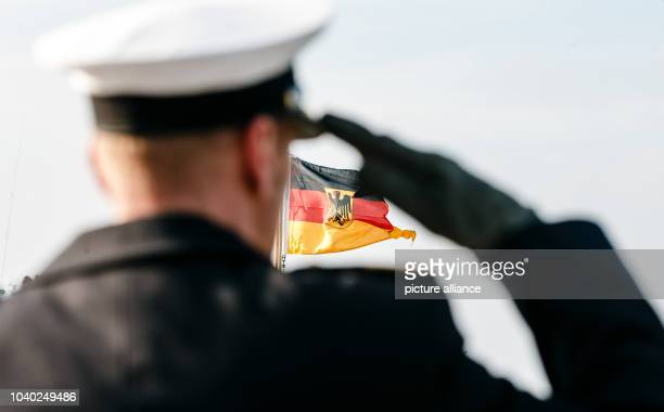 With the raising of the flag German navy's newest submarine is put into service at the naval base in Eckernfoerde Germany 23 March 2015 Photo Markus...
