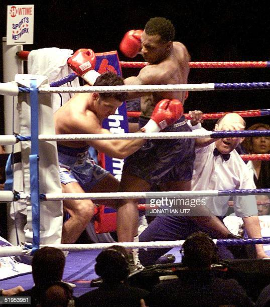 With the referee down on the mat Mike Tyson lays into Lou Savarese during the first round of their scheduled 10round bout at Hampden Park in Glasgow...