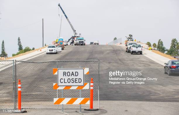 With the road still closed, construction crews continue working on the new Slater Avenue bridge over the 405 freeway in Fountain Valley on Wednesday,...