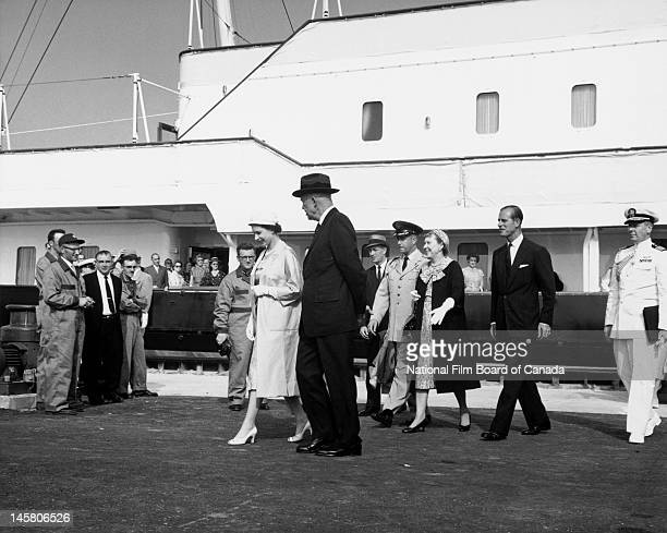 With the Royal Yacht Britannia in the background, Queen Elizabeth II and US President Dwight D. Eisenhower , followed by Prince Philip, Duke of...