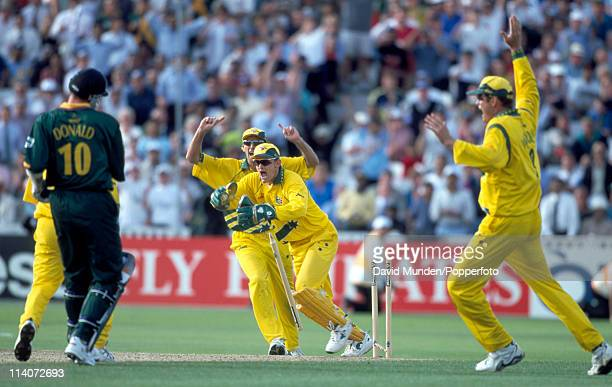 With the scores level Allan Donald of South Afrcia is run out by Australian wicketkeeper Adam Gilchrist to end the World Cup SemiFinal between...