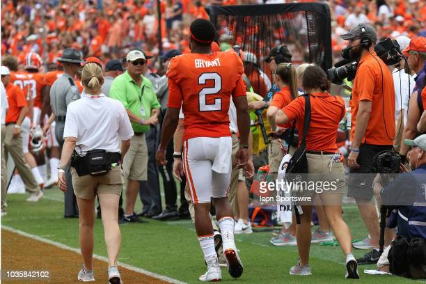 With the second half underway Kelly Bryant quarterback Clemson University Tigers makes it back to the sidelines during action between Georgia...
