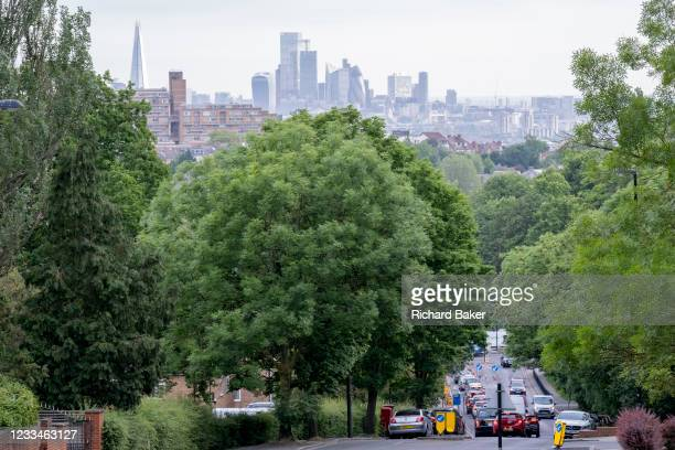 With the skyscrapers of the City of London, the capital's financial district, in the distance, rush-hour traffic builds at the bottom of Sydenham...
