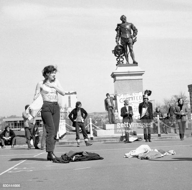 With the statue of Sir Francis Drake in the background Sue Rogers of St Albans stripped to her bra in front of holidaymakers on Plymouth Hoe in a...