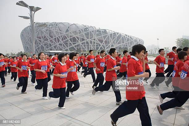With the striking Beijing National Stadium looming in the background some of a group of approximately 10,000 runners set off on a 13 km marathon fun...