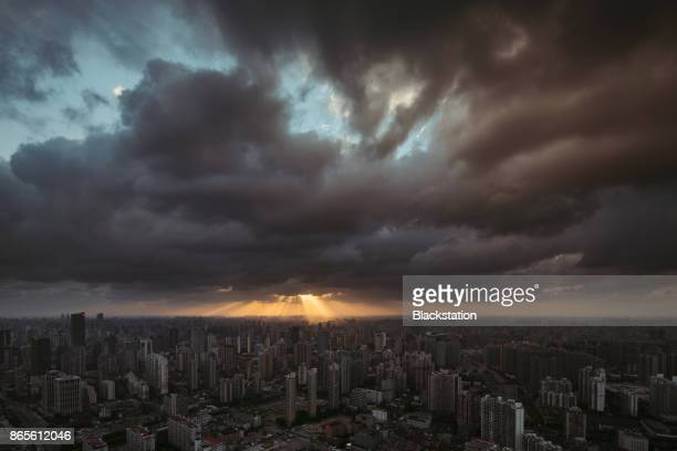 with the sunshine and clouds above the horizon - storm cloud stock pictures, royalty-free photos & images