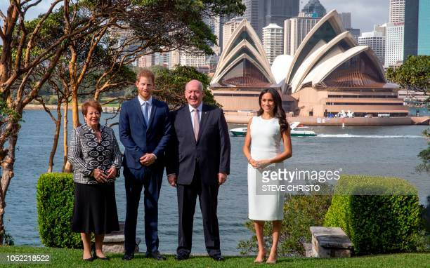 With the Sydney Opera House in the background Britain's Prince Harry and his wife Meghan meet Australian GovernorGeneral Peter Cosgrove and his wife...