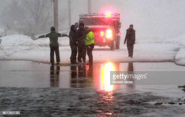 With the tide receding but the road still closed people checked out the flooding on the Causeway in Essex Mass during Jan 4 2018 blizzard The...