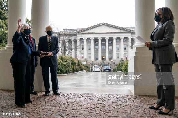 With the U.S. Treasury Building behind them, U.S. Vice President Kamala Harris participates in a ceremonial swearing-in of new Treasury Secretary...