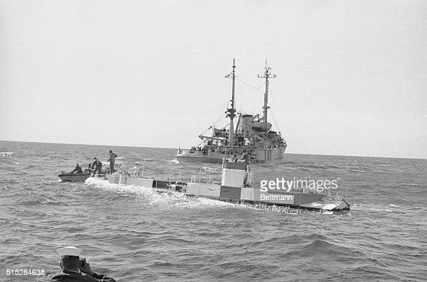 With the USS Preserver , the bathyscaph Trieste prepares to dive in the Atlantic in search for traces of the sunken submarine Thresher which sank...