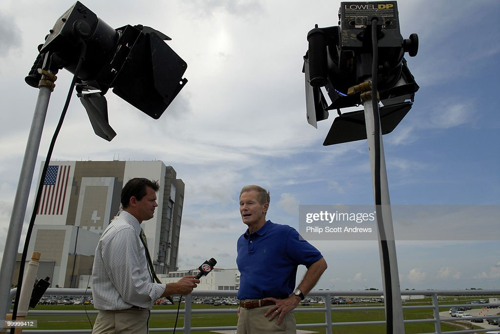 With the Vehicle Assembly Building behind him, Senator Bill Nelson D-Fla, talks to a local television crew on the roof of the Florida Today building in the press center the day of the first attempt at Kennedy Space Center.