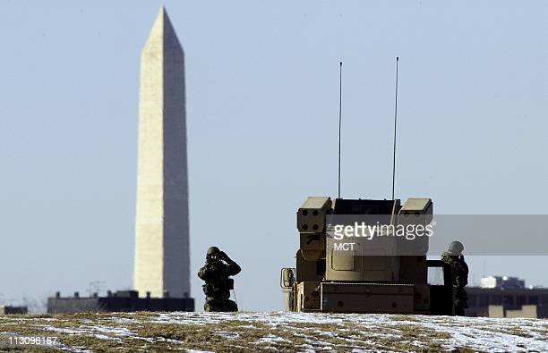 WASHINGTON DC With the Washington Monument in the background soldiers accompanied by a Humvee with mounted antiaircraft missiles patrol Washington DC...