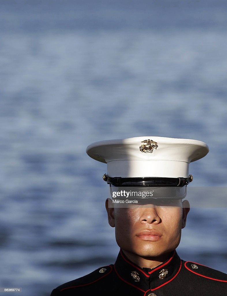 With the waters of Pearl Harbor in the background, a U.S. Marine stands at attention during the ceremony honoring the 64th anniversary of the surprise attack on Pearl Harbor, December 7, 2005 at Pearl Harbor, Hawaii. Around the country, Pearl Harbor survivors and others paid tribute to those lost during the December 7, 1941 Japanese bombing of Pearl Harbor.
