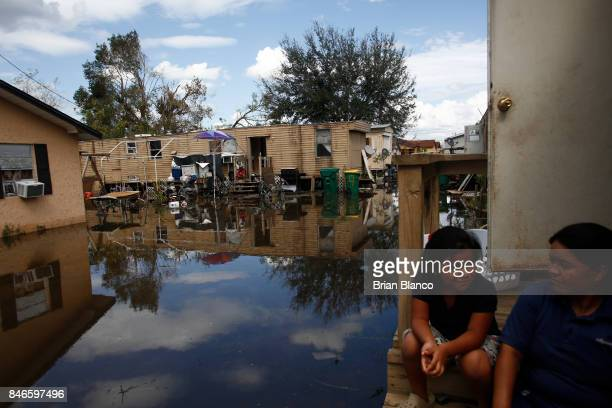 With their homes surrounded by water that they fear may be contaminated by waste water residents deal with the aftermath of Hurricane Irma on...