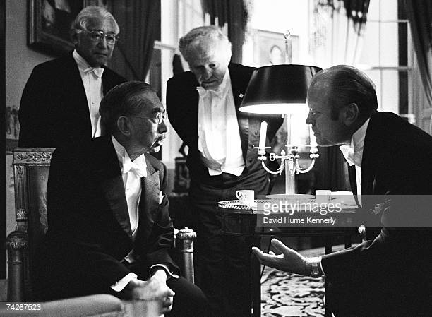 With their interpreters to aid them Emperor Hirohito of Japan and President Gerald R Ford chat in the Blue Room on the occasion of the state dinner...