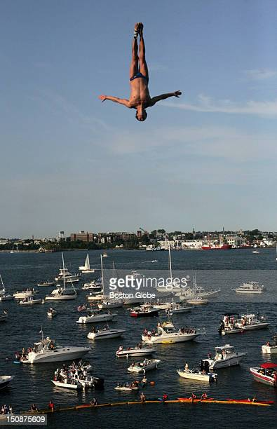 With thousands of people gathered at Fan Pier and Boston Harbor, a diver jumps from the platform built onto the Institute of Contemporary Art during...