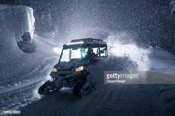 UTV with tracks in powder snow