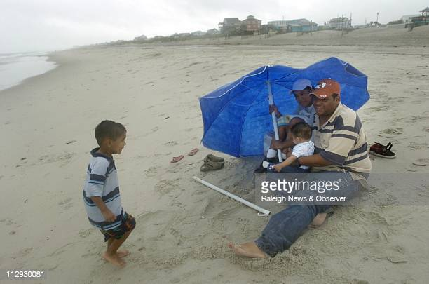 With Tropical Storm Gabrielle looming offshore Jose and Minerva Perez tried to squeeze in a few extra minutes at the beach with their children Manuel...