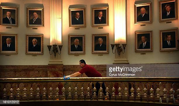 With US Presidents from Theodore Roosevelt to Richard Nixon watching over him Joe Jiron washes the top rail of brass in the Gallery of Portraits of...