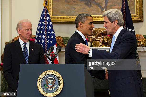 With Vice President Joe Biden looking on US President Barack Obama nominates Sen John Kerry to be the next Secretary of State in the Roosevelt Room...