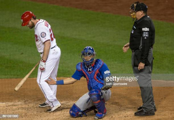 With Washington Nationals second baseman Daniel Murphy at home plate Chicago Cubs catcher Willson Contreras looks to the bench for a play during game...