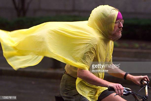 With wind gusts blowing down Clarendon Street along with heavy rain a bicyclist braves the elements as he slowly pedals against the wind in front of...