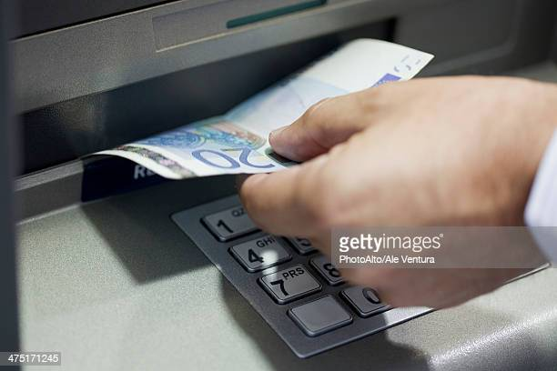 withdrawing cash from atm - twenty euro banknote stock photos and pictures