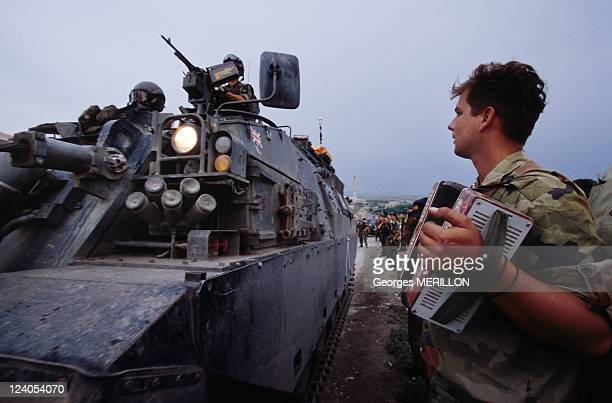Withdrawing of the Serb army In Pristina Yugoslavia On June 15 1999 Serb Soldier in front of English Tank