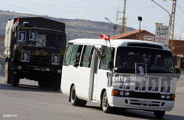 Withdrawing Syrian intelligence vehicles brandishing pictures of president Bashar Assad and loaded with agents and troops head to Syria through the...